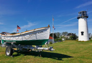 Cape Cod lifesaving boat and lighthouse