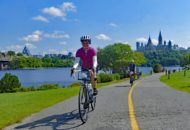 Ottawa bicycle tour cyclists on bike path along the river