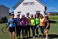 women cyclists at one room schoolhouse during a women's bike tour
