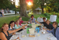 women's weekend bike tour group toasting before dinner on lake champlain