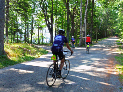 Summer bike tour cyclists in Acadia National Park