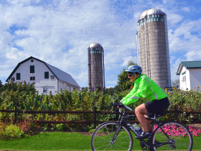 Sojourn cyclist during a summer bike tour in the Finger Lakes