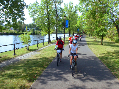 Sojourn cyclists ride the Lacine Canal during a summer bike tour