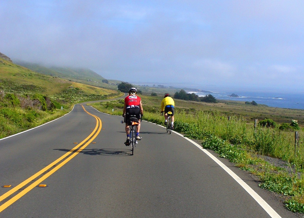 Sojourn cyclists riding bikes down the California coast on a wine country cycling tour