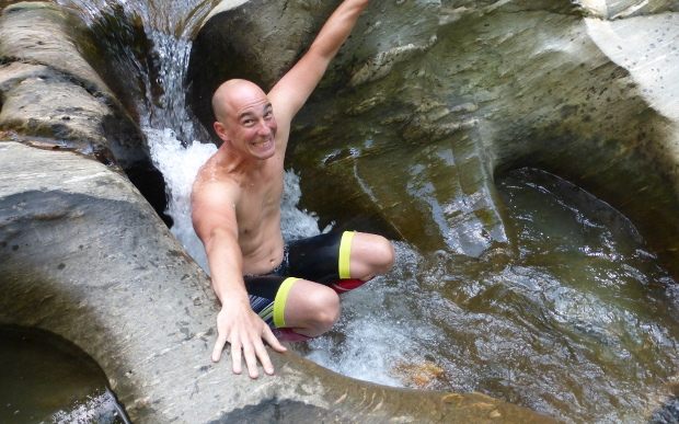 A Sojourn cyclist cooling off in a Vermont swimming hole
