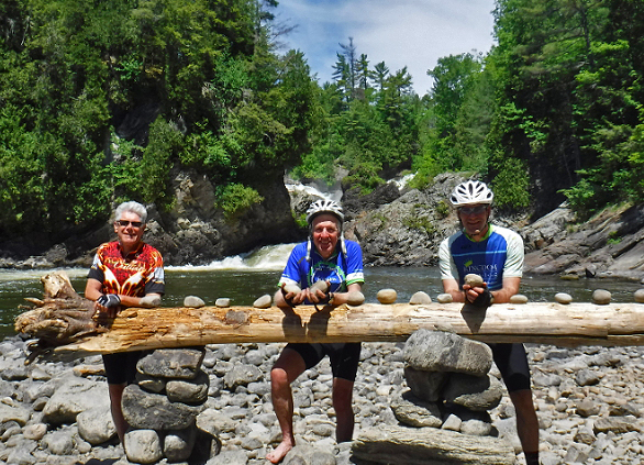 A Sojourn tour pausing to enjoy waterfalls in Canada.