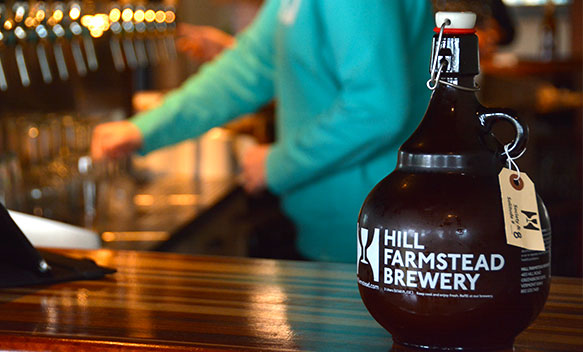 Hill Farmstead growler of Society & Solitude during a Sojourn Bike and Brew Tour