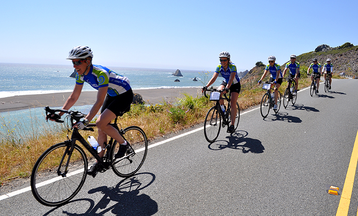 Sojourn group tour cyclists enjoying the pacific coastline during a Sonoma Wine Country & Coast bike tour.